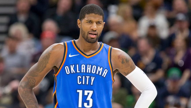Oklahoma City Thunder forward Paul George (13) reacts to a call during the first half against the Utah Jazz at Vivint Smart Home Arena.