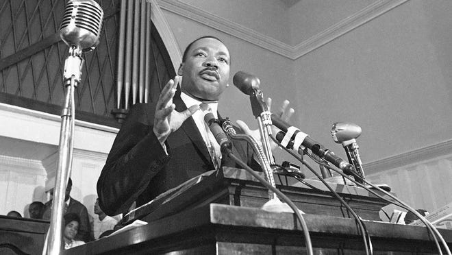 In this 1960 photo, Martin Luther King Jr. speaks in Atlanta. The civil rights leader had carried the banner for the causes of social justice -- organizing protests, leading marches and making powerful speeches exposing the scourges of segregation, poverty and racism.