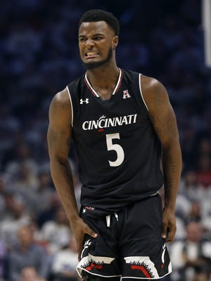 Cincinnati Bearcats freshman guard Trevor Moore stopped a Memphis surge with a clutch 3-pointer in the second half Saturday night, helping spur UC to a 62-48 win.