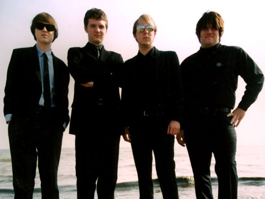 An early version of the Singles in Detroit in 2003. Left to right: Vince Frederick, Will Yates, Dave Lawson, Dave Knepp
