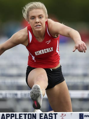 Kayla Vandehey of Kimberly races to first place in the 100-meter hurdles at the Fox Valley Association track and field championships Monday in Appleton. To see more photos, go to postcrescent.com.