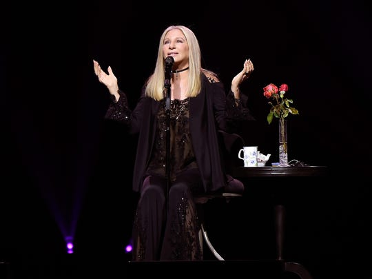 Barbra Streisand performs onstage during the tour opener