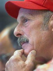 Farmer Tom Marston, of Pittsfield, N.H., listens during
