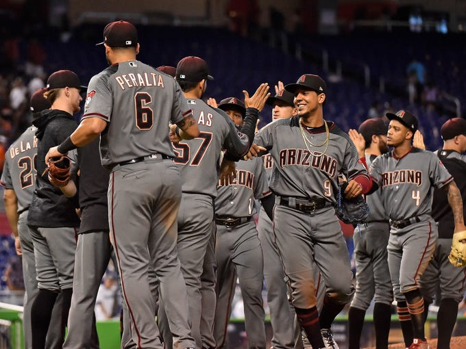 Arizona Diamondbacks celebrate after defeating the
