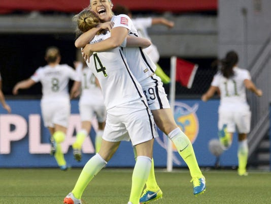 The United States' Julie Johnston (19) and Becky Sauerbrunn (4) celebrate after Carli Lloyd scored a goal against China during the second half of Friday's World Cup quarterfinal in Ottawa, Ontario. The Americans won, 1-0, to advance to Tuesday's semifinal against Germany.