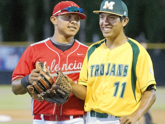 Gary Mook/For the Las Cruces Sun-News   Mayfield Trojans pitcher Eric Lucero gets congratulated by Valencia shortstop Carlos Ramirez after an easy inning Friday night at the North/South All Star Game at Apodaca Park.