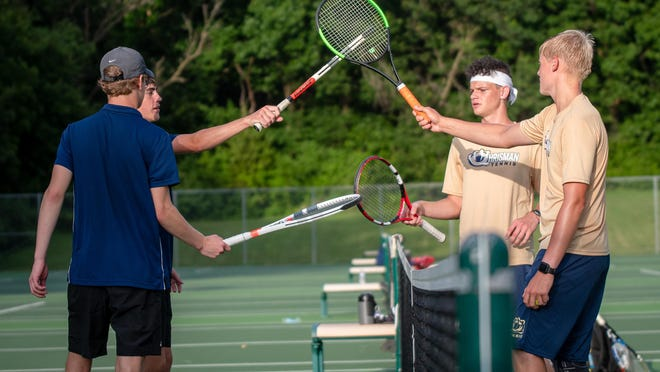 Truman's Caleb Allen and Aaron Muller and William Chrisman's Jordan Twenter and Sam Hawley, from left to right, bump rackets after their No. 1 doubles match. Allen and Muller won to help Truman to a 7-2 victory in the final of two summer matches between the rivals.