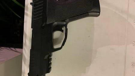 The replica gun found during an arrest that left an officer injured.