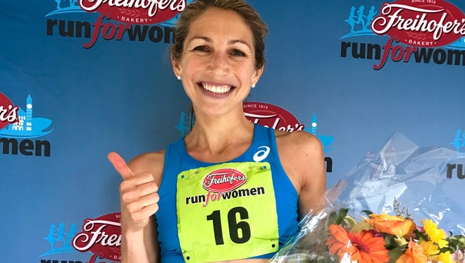 Sara Hall of Redding beams after winning the Freihofer's Run for Women 5K in Albany, N.Y.