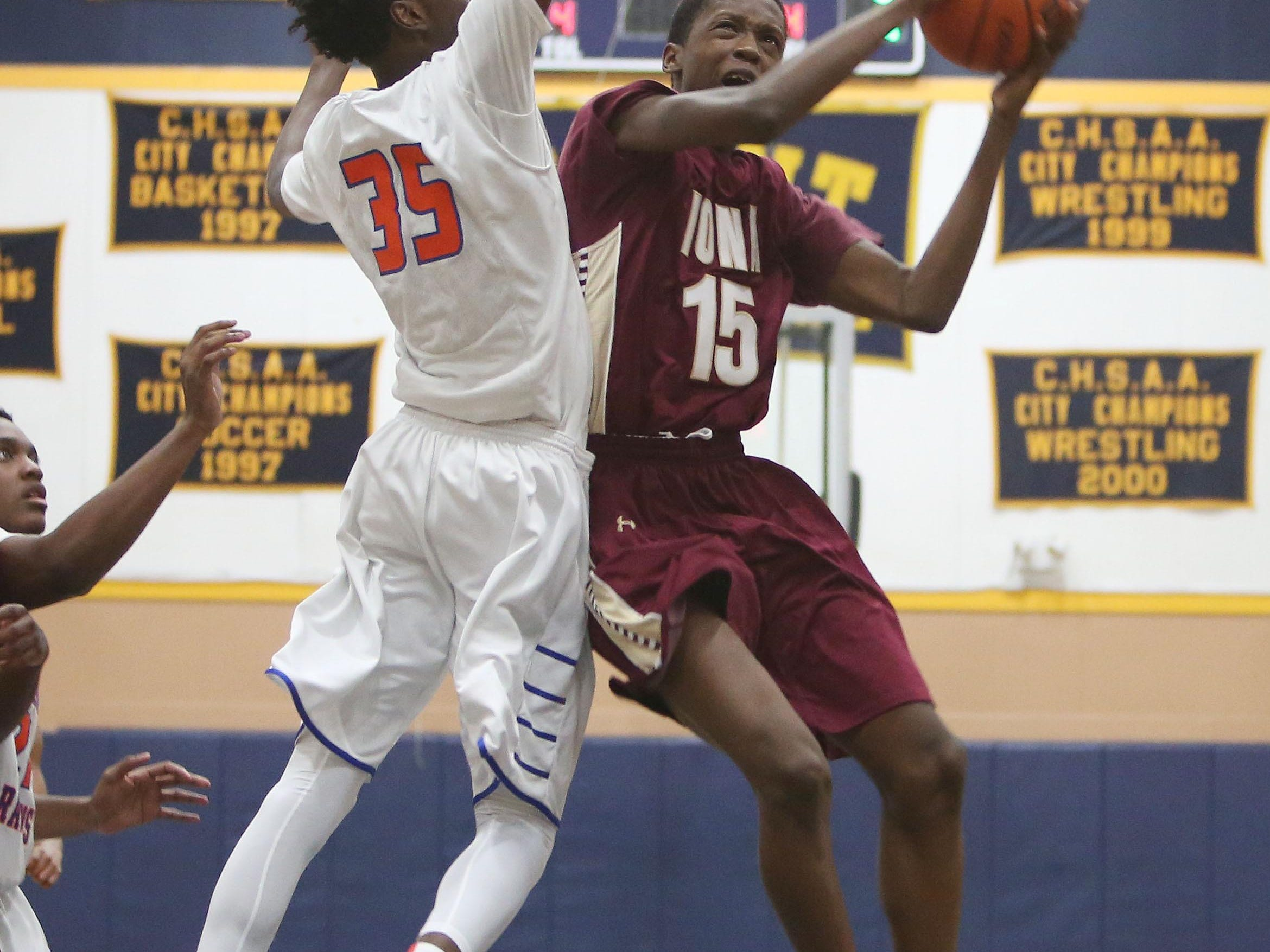 Iona's Souleymane Koureissi (15) finds his path to the basket blocked by Saint Raymond's Sidney Wilson (35) during the CHSAA Archdiocesan tournament semifinal at Mount Saint Michael Academy in the Bronx Feb. 23, 2016. Saint Raymond won the game 55-47.