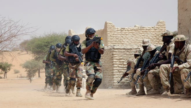 In this March 7, 2015 file photo, Nigerian special forces and Chadian troops participate with U.S. advisers in the Flintlock exercise in Mao, Chad. American and French forces have spent years providing training and support to the militaries of Mali, Niger and other vulnerable countries in this corner of Africa, where Islamic extremism has become entrenched over the past decade.