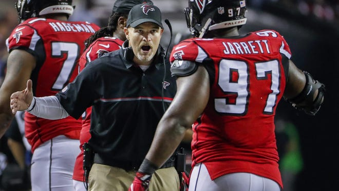 Atlanta Falcons coach Dan Quinn greets Atlanta Falcons defensive tackle Grady Jarrett after forcing the Seattle Seahawks to kick a field goal during the second half of Saturday's game.