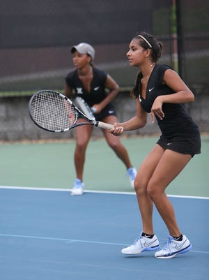 Xavier's Sydney Liggins (left) was named Big East women's tennis player of the year Thursday while her doubles partner, Amina Ismail, joined her on the all-conference team.