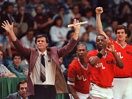 Louisville coach Denny Crum gestures toward his team