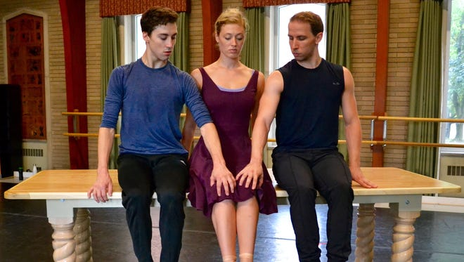 RCB dancers Megan Kamler, Ben Rabe and Christopher Collins rehearse in studio with the table that serves as the central prop for the ballet's dream-like movements.