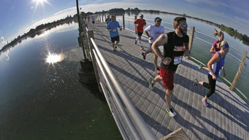 Runners cross the Fox Cities Trestle Friendship Trail during the half marathon portion of the Community First Fox Cities Marathon in 2015.