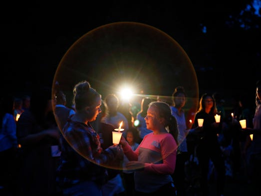Kaylee Wood, 13 lights a candle for Emma Hoops, 10,