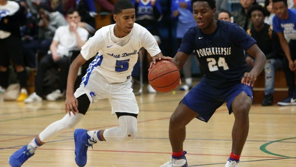 Saunders defeated Poughkeepsie 59-55 in boys basketball