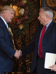 Then President-electDonald Trump (L) with former Wisconsin