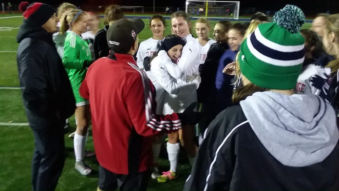 Glen Ridge celebrating after topping Mountain Lakes in double overtime to advance to Group 1 championship.