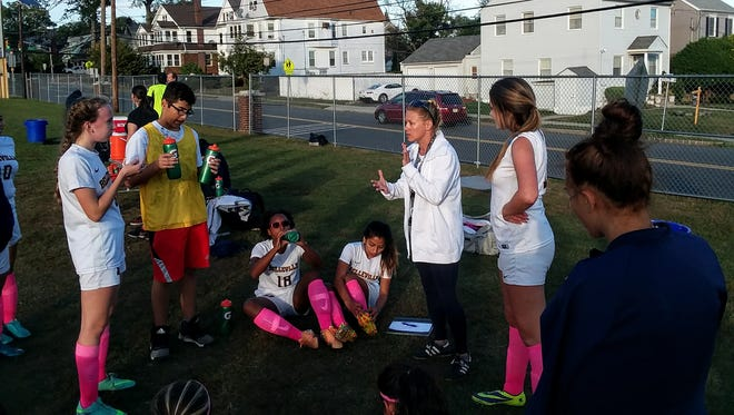 Coach Beth Ann Garrett encouraging Belleville girls soccer team at halftime of game with Pompton Lakes. The Bucs won, 3-2, in overtime.