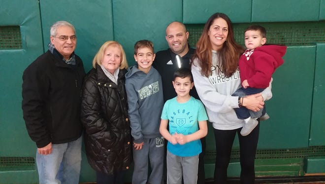Passaic Valley coach Joe Benvenuti (third from right), with his wife Sue and the couple's three sons, Dante (to Joe's right), Gianluca (in front) and Marcello (with his mother), along with Benvenuti's parents Mary and Joseph.