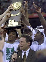 Charlie Bell holds up the National championship trophy as the team in 2000.