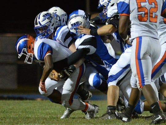 Millville quarterback Elijah Nichols is sacked by four