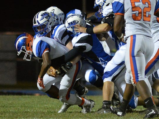 Millville quarterback Elijah Nichols is sacked by four