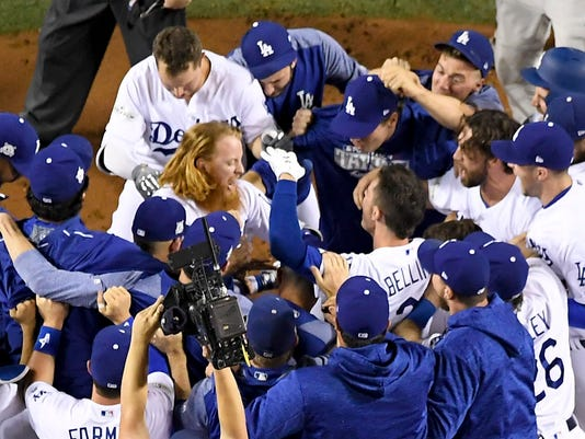 Los Angeles Dodgers' Justin Turner celebrates after a three-run walk off home run against the Chicago Cubs during the ninth inning of Game 2 of baseball's National League Championship Series in Los Angeles, Sunday, Oct. 15, 2017. The Dodgers won, 4-1. (AP Photo/Mark J. Terrill)