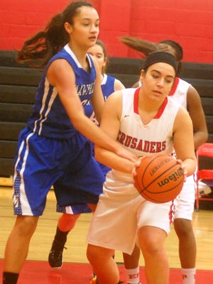 Elmwood Park's Isabella Metri holding the ball despite being defended by Mary Help's Emily Toresi.