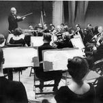 Wilford Crawford, conductor of the Rochester Community Orchestra, directs the group in a number at the opening concert at the JYM&WA in 1960.