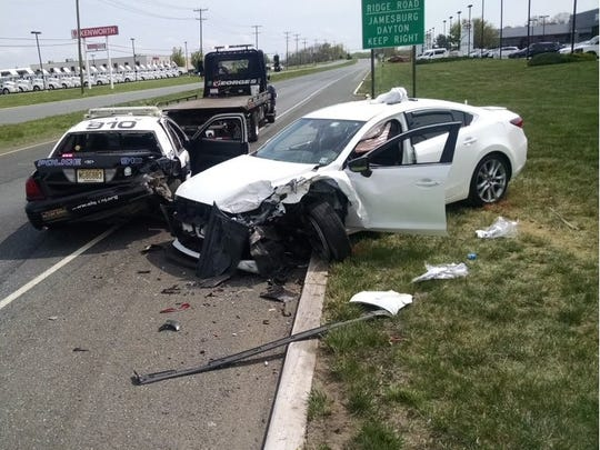 A South Brunswick police officer was hospitalized after his vehicle was rear-ended during a motor vehicle stop on Route 1 on Monday.