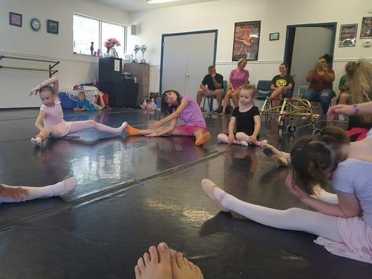 Amy Trammell's little ballerinas warm up.