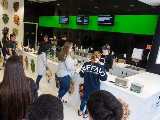People line up inside the original Dough Life location