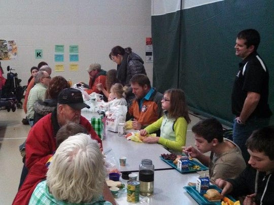 Jeff Fischer's sixth-grade class at Madison School had their parent luncheon last Friday. Pictured is Fischer sharing a laugh with his students and their parents during the luncheon.