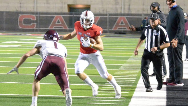 Lake Travis receiver Isaac Norris looks to get past Austin High defensive back Jack Scarbrough during the Cavaliers' 62-20 win Friday. Norris caught two touchdown passes and ran for another score in the victory.