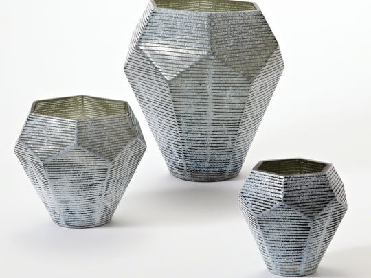 This photo provided by Wayfair.com shows Stria vases. The Stria vase collection's hallmark is a graphic faceted shape. (AP Photo/Wayfair.com)