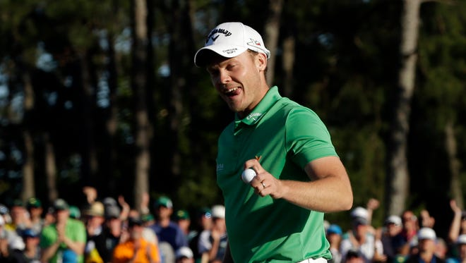 Apr 10, 2016; Augusta, GA, USA; Danny Willett reacts after putting on the 18th green during the final round of the 2016 The Masters golf tournament at Augusta National Golf Club.