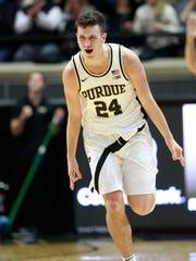 Purdue forward Grady Eifert reacts after making a basket