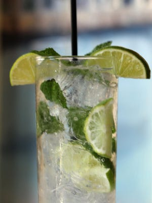 A tall glassful of Mojito with mint for that distinctive tang is one of the popular cocktails at the restaurant.