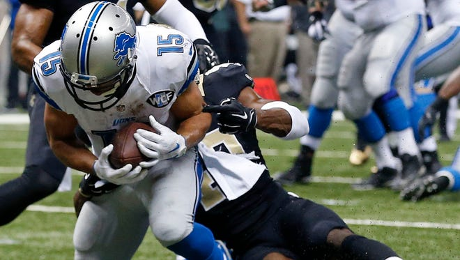 Detroit Lions wide receiver Golden Tate (15) pulls in a touchdown reception as New Orleans Saints cornerback Delvin Breaux tries to tackle in the first half of an NFL football game in New Orleans on Monday.