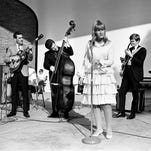 The girl from Dry Ridge, Kentucky, Skeeter Davis, front, wows a crowd of over 5,000 during The Tennessean's Centennial Park concert July 24, 1966. Members of Davis's band are guitarist Pete Wade, left, bassist Henry Strzelecki, electric guitarist Ronny Light and drummer Paul Charon.