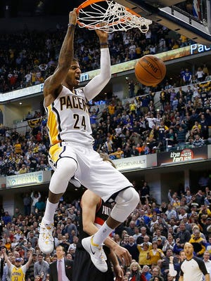 Pacers forward Paul George, an All-Star starter, dunks against the Blazers on Feb. 7.