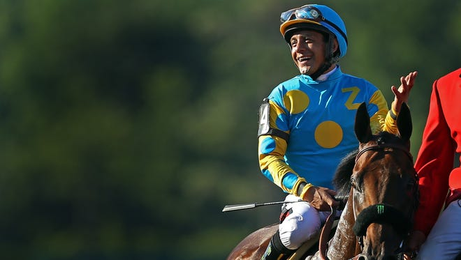 MONMOUTH, NJ - AUGUST 2: Victor Espinoza atop American Pharoah after winning the 48th William Hill Haskell Invitational at Monmouth Park on August 2, 2015 in Monmouth, New Jersey. (Photo by Adam Hunger/Getty Images) *** Local Caption *** Victor Espinoza; American Pharoah