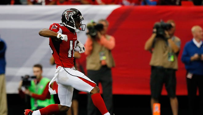 Taylor Gabriel #18 of the Atlanta Falcons celebrates a touchdown during the first half against the Arizona Cardinals at the Georgia Dome on November 27, 2016 in Atlanta, Georgia.