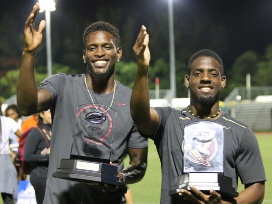 FSU's Corion Knight, the ACC Field MVP, and Andre Ewers, the Track MVP, celebrate an ACC Outdoors title by doing the Tomahawk Chop.