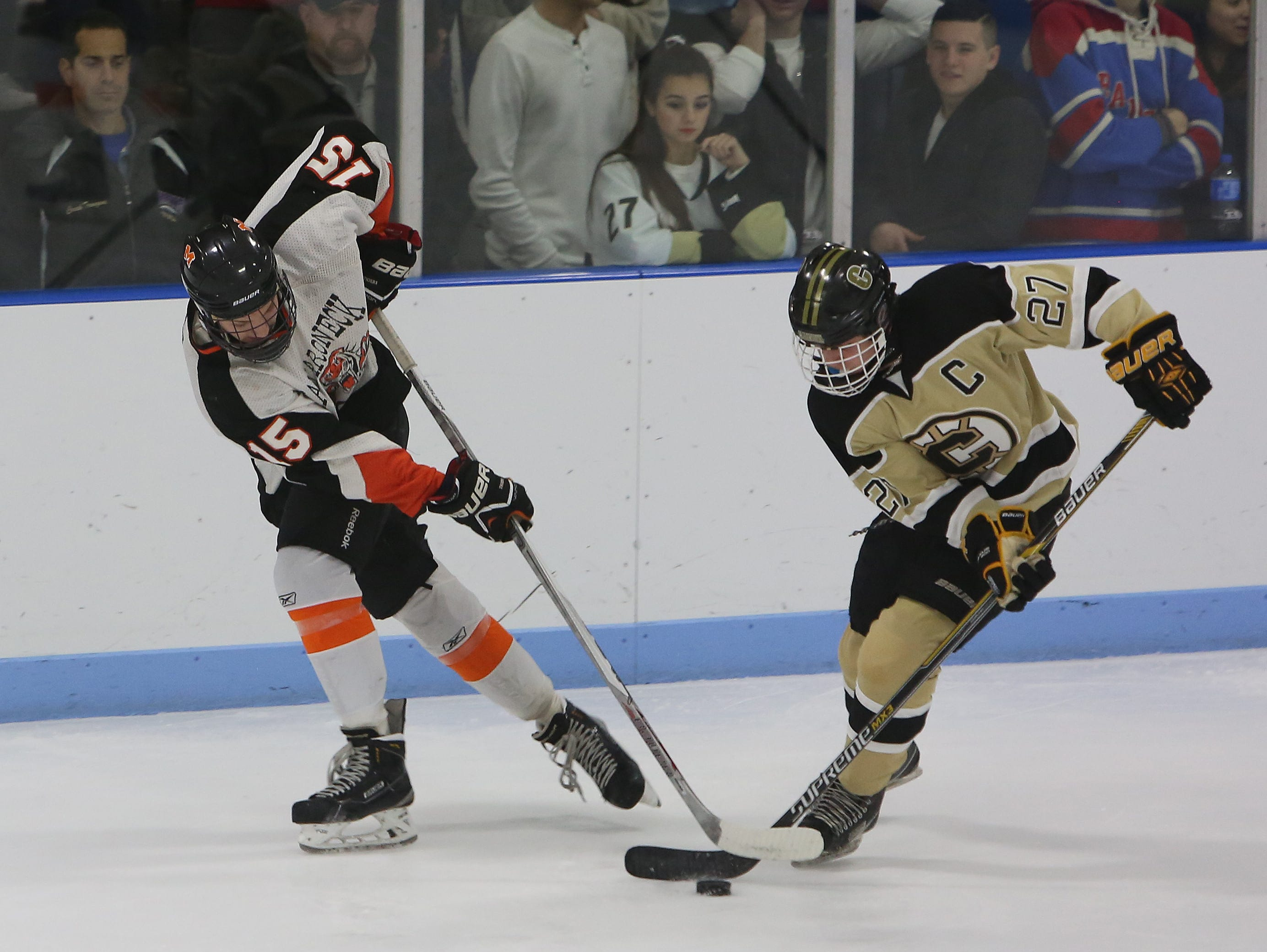 Mamaroneck's James Torre (15) and Clarkstown's Adam Marvin (27) battle for puck control during hockey action at Hommocks Park Ice Rink in Mamaroneck Dec. 22, 2015. Mamaroneck won the game 3-0.