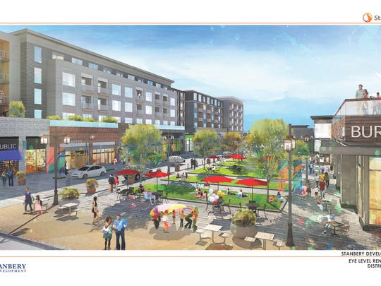 An architectural rendering of a proposed mixed-use development that would replace two vacant office buildings on Route 10 in Parsippany.