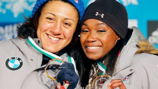Elana Meyers Taylor, left, and Cherrelle Garrett of the U.S display their medals after winning the women's bobsled competition at the World Championships  in Winterberg, Germany, Feb. 28.